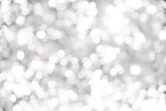 abstraktes weißes und graues bokeh beleuchtet Hintergrund Lizenzfreie Stockfotos