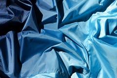 Abstraktion av blått tyg Arkivfoton
