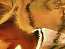 Abstraktion av en skinande guld- bakgrund Royaltyfri Bild
