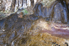 Abstraktion in der Farbe und Beschaffenheit vom nassen Felsen Lizenzfreie Stockfotografie