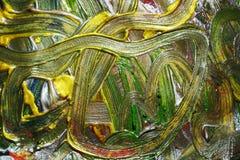 Abstraktion der flüssigen Goldgrünbürste streicht Farbe Aquarellfarben-Zusammenfassungshintergrund Lizenzfreie Stockbilder