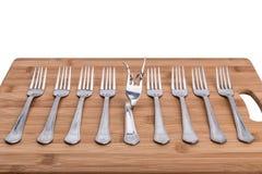 Abstraktion der Küchengabeln und eines Gabelverbiegens Lizenzfreies Stockfoto