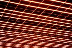Abstraktion der Leuchtdiode zeichnet, Laser eines roten Schattens einer Oberfläche auf einem dunklen Hintergrund Stockfotos