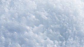 Abstraktion des Schnees mit Löchern Stockbilder
