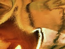 Abstraktion eines glänzenden Goldhintergrundes Lizenzfreies Stockbild