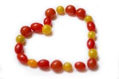Abstraktion: Tomaten in Form des Herzens Lizenzfreie Stockfotos