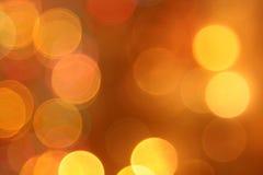 Abstrakty zamazujący złoci kółkowi bokeh światła Zdjęcie Royalty Free