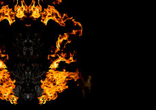 Abstrat-Teufelgesicht vom Feuer auf Dunkelheit Stockfotos