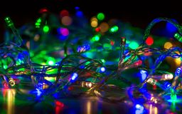 Abstraction colorful bokeh of Christmas garlands. Abstraction colorful bokeh of Christmas garlands Royalty Free Stock Photography