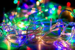 Abstract colorful bokeh of Christmas garlands. Abstract colorful bokeh of Christmas garlands Stock Photo