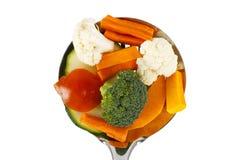 Abstreicheisen mit vegatables Stockbild