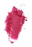 Abstrich des zerquetschten glänzenden rosa Lidschattens als Probe des kosmetischen Produktes Lizenzfreies Stockfoto