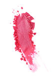 Abstrich des zerquetschten glänzenden rosa Lidschattens als Probe des kosmetischen Produktes Stockfotos