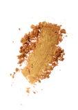 Abstrich des zerquetschten goldenen Lidschattens als Probe des kosmetischen Produktes Lizenzfreies Stockbild