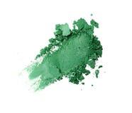 Abstrich des zerquetschten grünen Lidschattens als Probe des kosmetischen Produktes Stockbild