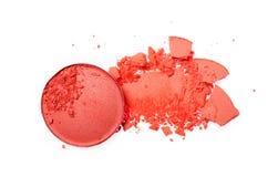 Abstrich des zerquetschten orange Lidschattens als Probe des kosmetischen Produktes Stockfotografie