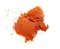 Abstrich des zerquetschten orange Lidschattens als Probe des kosmetischen Produktes Lizenzfreie Stockfotografie