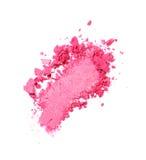 Abstrich des zerquetschten rosa Lidschattens als Probe des kosmetischen Produktes Stockfotos