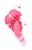 Abstrich des zerquetschten rosa Lidschattens als Probe des kosmetischen Produktes Stockbilder