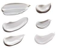Abstrichcreme lokalisiert auf weißem Hintergrund Sahnebeschaffenheit Stockfoto