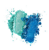 Abstriche der zerquetschten Knickente und des blauen glänzenden Lidschattens als Probe des kosmetischen Produktes Stockbilder