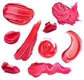 Abstriche Lippenstift und Lipglossvielzahl von Formen Lizenzfreie Stockbilder