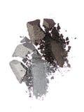 Abstriche von zwei zerquetschten grauen Lidschatten als Probe des kosmetischen Produktes Lizenzfreie Stockfotografie