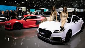 ABT Tuning Audi models. GENEVA, SWITZERLAND - MARCH 7, 2018: Models posing with tuned Audi cars from ABT Tuning at the 88th Geneva International Motor Show royalty free stock photos