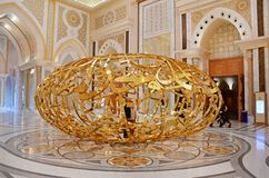 Abu Dhabi, Arab Emirates, March, 19, 2019. People walking near sculptural composition ` the power of words` in Presidential Palace. Abu Dhabi, Arab Emirates royalty free stock image