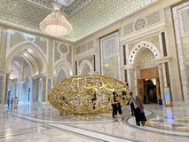 Abu Dhabi, Arab Emirates, March, 19, 2019. People walking near sculptural composition ` the power of words` in Presidential Palac. Abu Dhabi, Arab Emirates royalty free stock photography