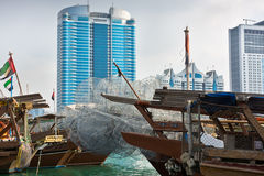 Abu Dhabi buildings skyline with old fishing boats. On the front Stock Photo