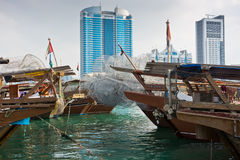 Abu Dhabi buildings skyline with old fishing boats Royalty Free Stock Photo