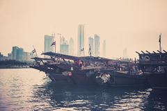 Abu Dhabi buildings skyline with old fishing boats Royalty Free Stock Photography