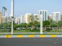 Abu Dhabi city skyline - beautiful corniche view. Abu Dhabi city skyline and parks - beautiful corniche view royalty free stock images