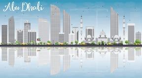Abu Dhabi City Skyline con Gray Buildings, cielo blu e riflette Fotografie Stock