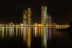 Abu Dhabi corniche skyline at night. ABU DHABI, CORNICHE - CIRCA APRIL 2014 - A night time photograph showing the hilton hotel and jumeirah towers Stock Image