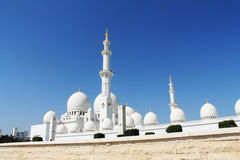 The Abu Dhabi Mosque on the blue background. The white Abu Dhabi Mosque on the blue background royalty free stock photos