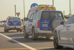 Abu Dhabi Police vehicles at incident scene stock photos