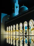 Abu Dhabi Sheik Zayed Mosque beautiful details and architecture with reflections on water at night royalty free stock image