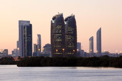 Abu Dhabi skyline at dusk Stock Images