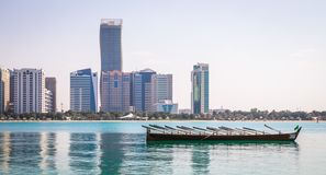 Abu Dhabi Skyline at sunset with boat royalty free stock image