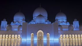 Abu Dhabi, U.A.E. - Jan, 2018: Sheikh Zayed Grand Mosque, amazing and epic frontal view on facade in night stock footage