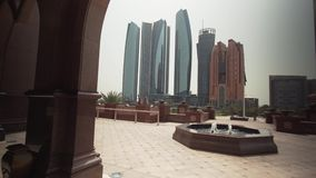Skyscrapers in Abu Dhabi view from the hotel Emirates Palace stock footage video. Abu Dhabi, UAE - April 04, 2018: Skyscrapers in Abu Dhabi view from the hotel stock footage
