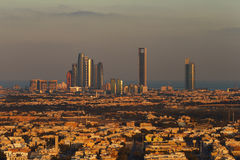 Abu Dhabi, UAE at dawn, showing the Corniche and Etihad Towers. Abu Dhabi, UAE. A skyline view of Abu Dhabi at dawn, looking towards the Corniche and showing Royalty Free Stock Images
