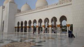 Abu Dhabi, UAE - March 31. 2019. Tourists in Sheikh Zayd Grand Mosque. Abu Dhabi, UAE - March 31. 2019. Tourists in The Sheikh Zayd Grand Mosque stock video footage