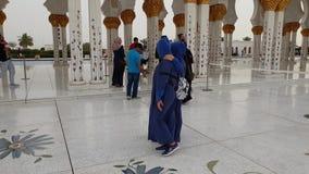Abu Dhabi, UAE - March 31. 2019. Tourists in Sheikh Zayd Grand Mosque. Abu Dhabi, UAE - March 31. 2019. Tourists in The Sheikh Zayd Grand Mosque stock footage