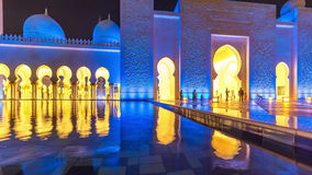 ABU DHABI, UAE - MAY 2017: Mosque reflected in the water. Evening lights reflected in the water. The interior of the stock video