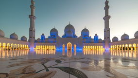 ABU DHABI, UAE - MAY 2017: Panoramic timelapse of Sunset in Sheikh Zayed Mosque in Abu Dhabi, United Arab Emirates stock footage