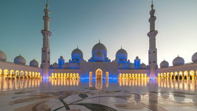 ABU DHABI, UAE - MAY 2017: Sunset timelapse in Sheikh Zayed Mosque in Abu Dhabi, United Arab Emirates. Transition of the stock video footage