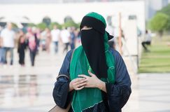 Veiled muslima woman. ABU DHABI, UNITED ARAB EMIRATES - DEC 28, 2017: A veiled muslima woman outside the Sheikh Zayed Mosque in Abu Dhabi Stock Images
